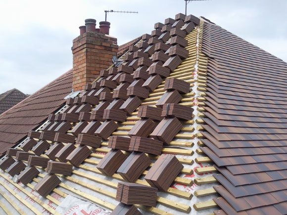 qualified roofer in altrincham - image shows partially compleyed roof
